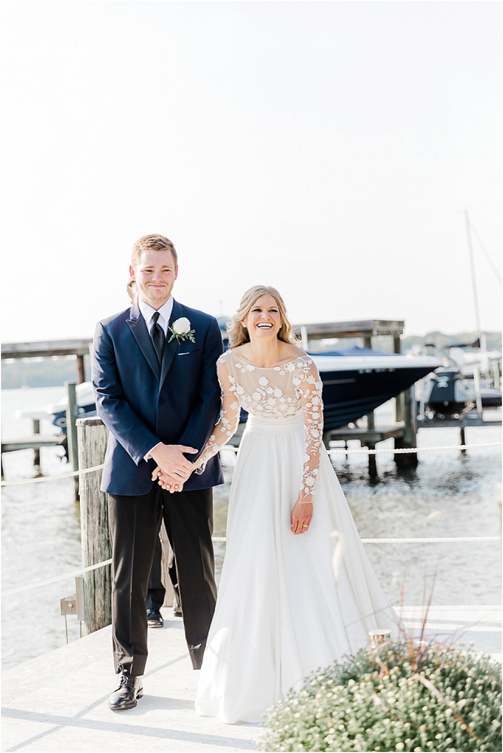 A playful Annapolis backyard wedding on the water featuring twinkle lights and greenery.