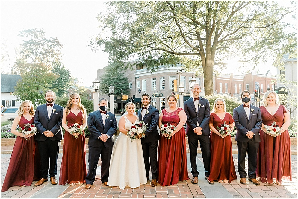 An Eastern Shore wedding in Downtown Easton, featuring deep red and purple hues and an incredibly joyful couple.